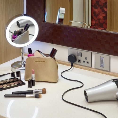 MK Inncom USB charging socket in hotel with light up mirror makeup and hairdryer electrical photography