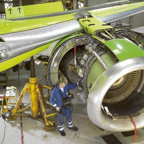 Technicial using iPlex Videoscope on Aircraft maintenance - Industrial photography