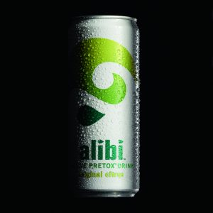 Can of Alibi soft drink with condensation on can against black background - Food and drink photography