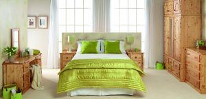 Green bedding on double bed, studio room set build - Furniture photography
