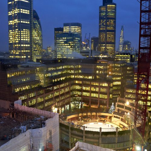 Aerial shot of construction at London Broadgate at night with buildings and cranes - Exterior/Location photography