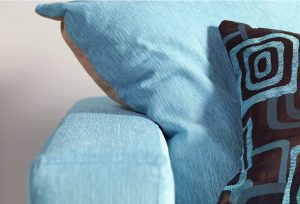 Close up of blue fabric on sofa arm and cushions - Furniture photography