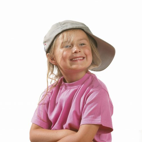 Little blonde girl doing a cheeky smile, wearing pink tshirt and baseball cap on its side against white background - People photography