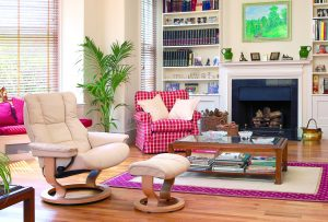 Cream leather recliner chair in lounge fireplace bookcases, Furniture photography