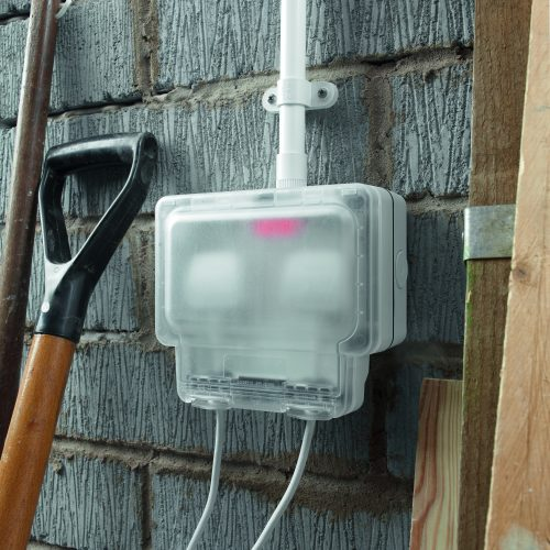 Clear cover for external socket in garage situation electrical photography