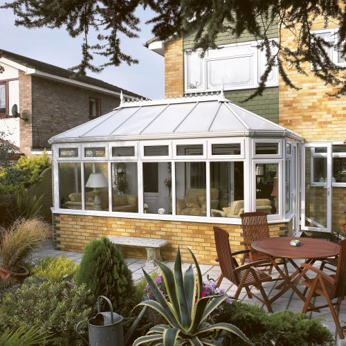 White PVC Conservatory and mature garden - Exterior photography