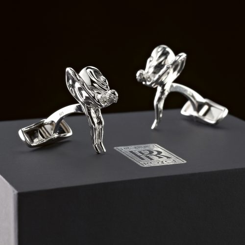Silver Rolls Royce cufflinks on top of presentation box - product photography
