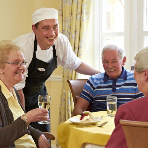 Group of Care-home Residents wine, afternoon tea with chef