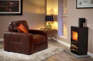 Chocolate brown arm chair in studio roomset with log burning stove - Furniture photography