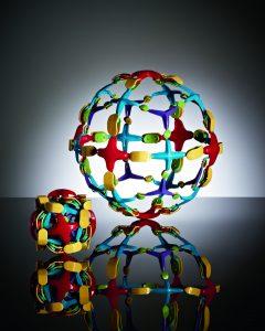 Expandability balls on black reflective surface concept photography