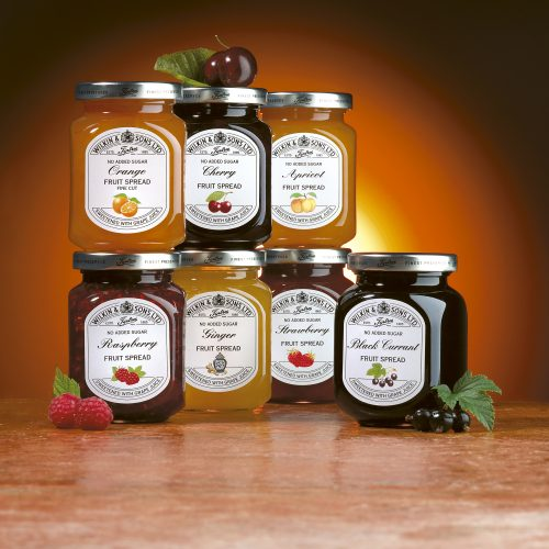 Group shot of Wilkins & Tiptree No added sugar fruit spread range - Food and drink photography