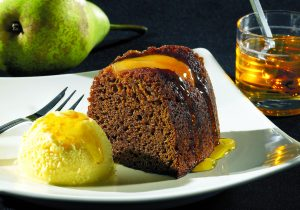 Ginger and Pear ring cake on white plate - Food and Drink Photography
