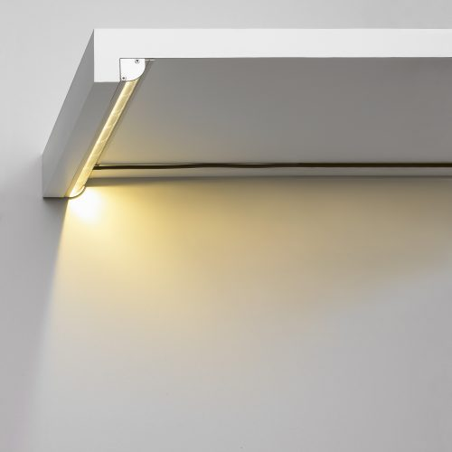 Underside of white shelf with LED light electrical photography