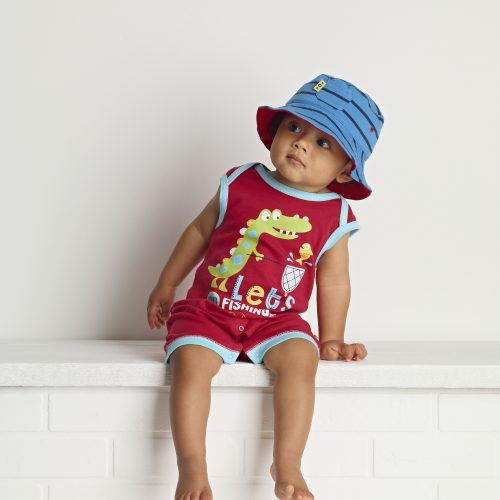 Toys R Us shot of toddler wearing Lets Go Fishing romper suit and hat sitting on a shelf - People photography