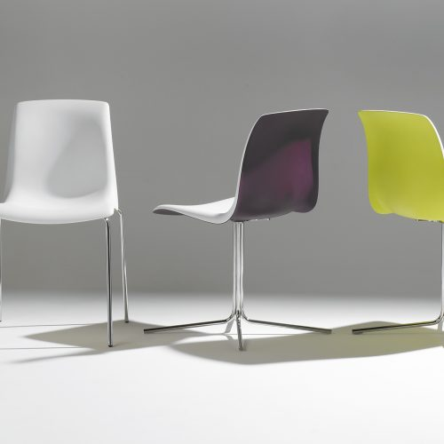 Line-up & stack of brightly coloured metal legged chairs Line-up & stack of brightly coloured metal legged chairs - Furniture photography