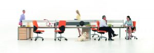 ong desking unit with people sitting on orange chairs and a dog - Furniture photography
