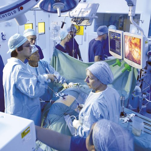 Olympus KeyMed shot of Operating theatre in action, surgeon - Industrial photography
