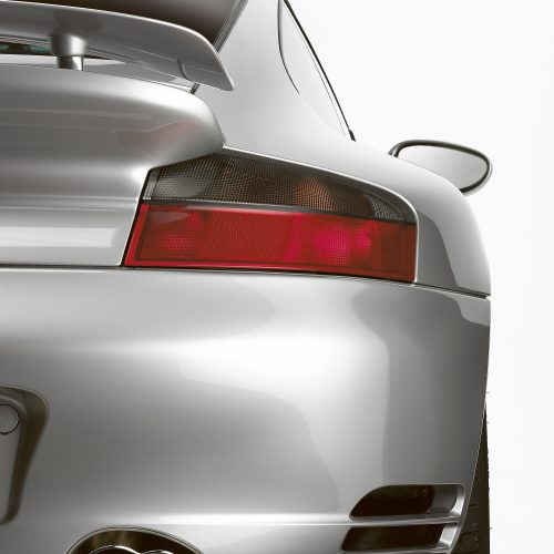 Close-up of silver Porsche brake light and exhaust - product photography