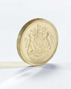 Close up of new shine pound coin on white background concept photography