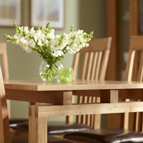 Close up of Ravenna Dining table with flowers - Furniture photography