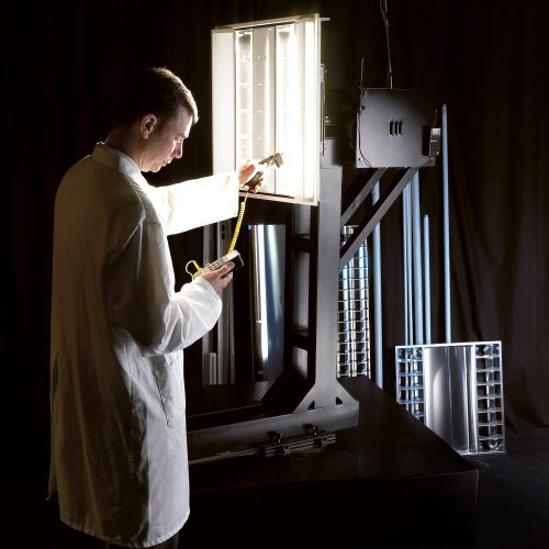 Man wearing white lab coat inspecting testing light electrical photography