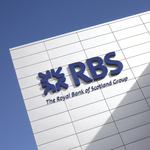 close up of RBS logo on building, blue sky - Exterior photography