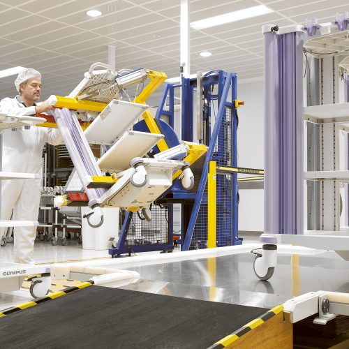 Olympus KeyMed operating trolley assembly line in factory - Industrial photography