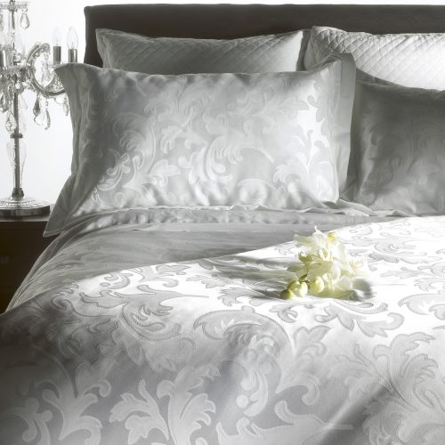 Studio shot of luxury bedding with flowers & crystal lamp - product photography