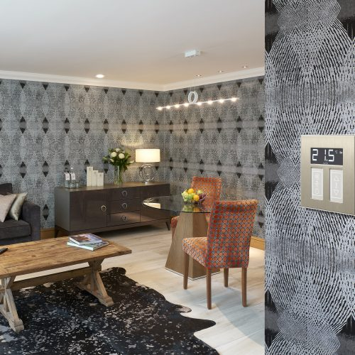 Alexander Hotel Lounge dining room suite with black grey wallpaper and rug electrical photography
